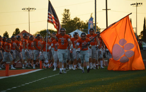 Varsity football defeats River Valley on strength of rushing game