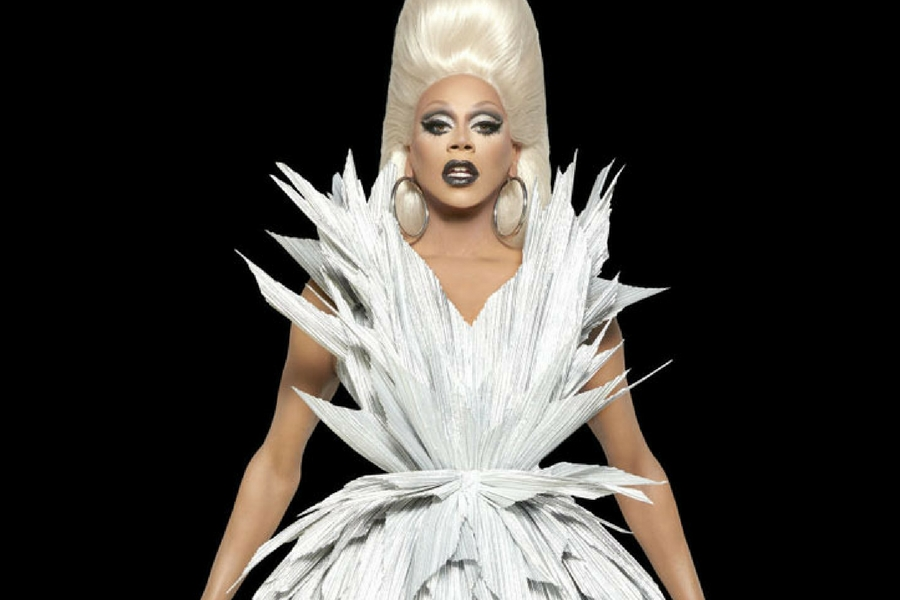 RuPaul poses in a jagged white gown for a season nine promotion of 'RuPaul's Drag Race.'