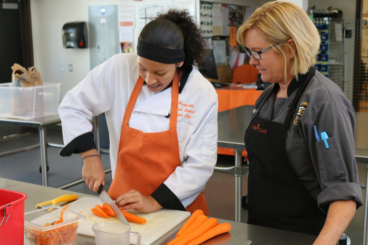 Students in RHS' culinary program work to prepare food in class. According to Culinary Arts teacher Angela Ash, CTE pathways provide students with real world experience.