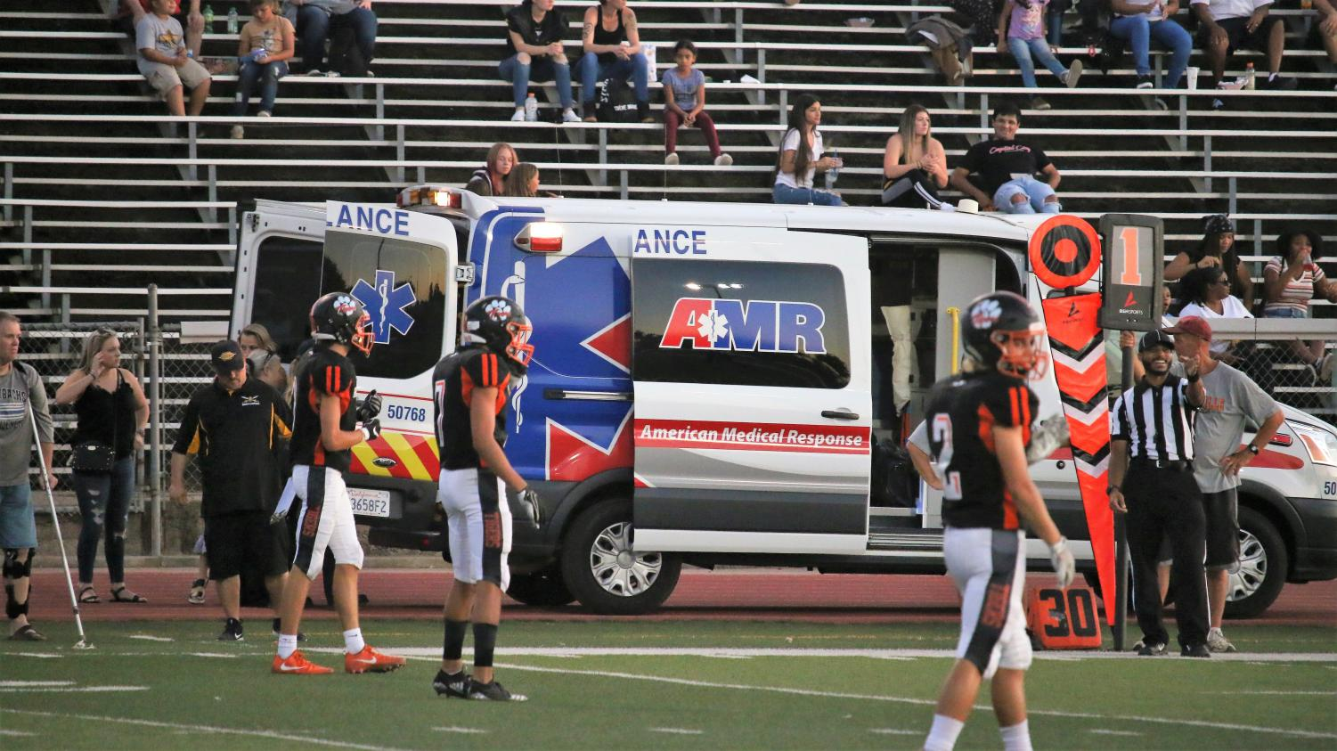 #24 Tyler Rhower is led away by EMTs after an apparent knee injury. He suffered a torn ligament in his ankle.