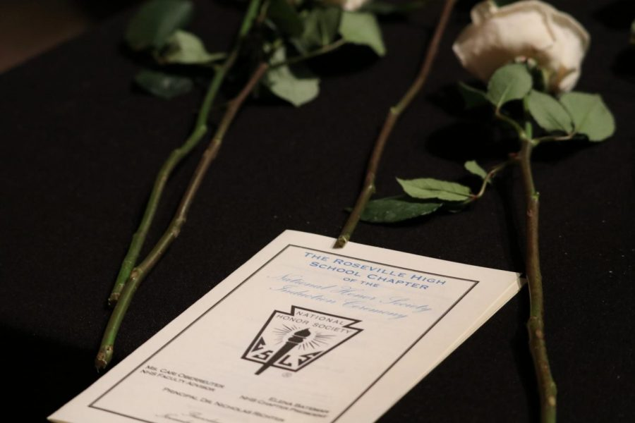 At+the+induction+ceremony%2C+students+received+a+certificate+and+a+rose+and+recited+a+pledge+to+the+National+Honors+Society.+
