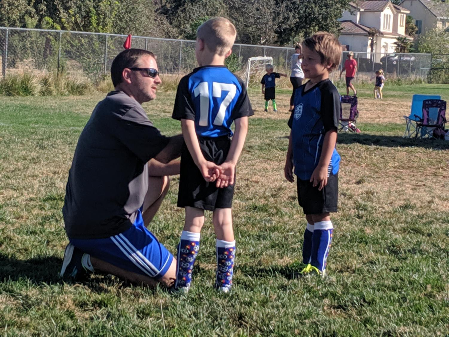 Teacher Kevin Fagan plays in a recreational soccer league and coaches both of his kids in soccer. Through the sport, he's been able to strengthen friendships with teammates and spend time with his children.
