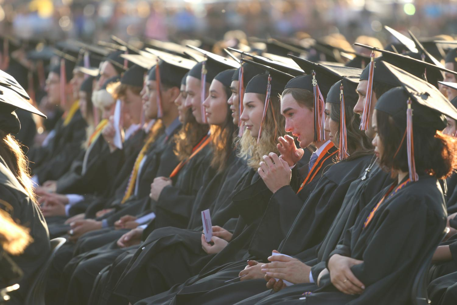 Students at last year's graduation. Changes in guidelines for graduation attire this year will allow students in club and elective programs to wear pre-approved memorabilia.